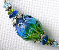 Necklace with Aqua, Green and Mauve Hollow Lampwork Bead
