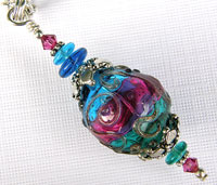 Necklace with Teal, Blue and Pink Hollow Lampwork Bead