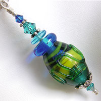 Necklace with Teal, Blue and Yellow Hollow Lampwork Bead