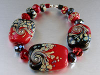 'VIXEN'  - Red, Black & Raku Lampwork Glass Bead Set - Focal + Spacers + Crystals
