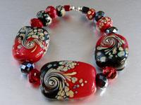 'VIXEN'  - Red, Black & Raku Lampwork Glass Bead Set - Focal + Spacers + Crystals